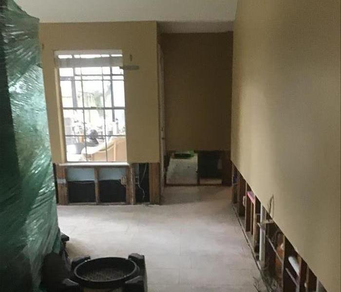 dining room with drywall cut out at the bottom from flood damage